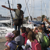 Photo  de � photo : D. van den Brink  GPO - Les enfants avec Echo Mer Transat 6.50 2011 La Rochelle